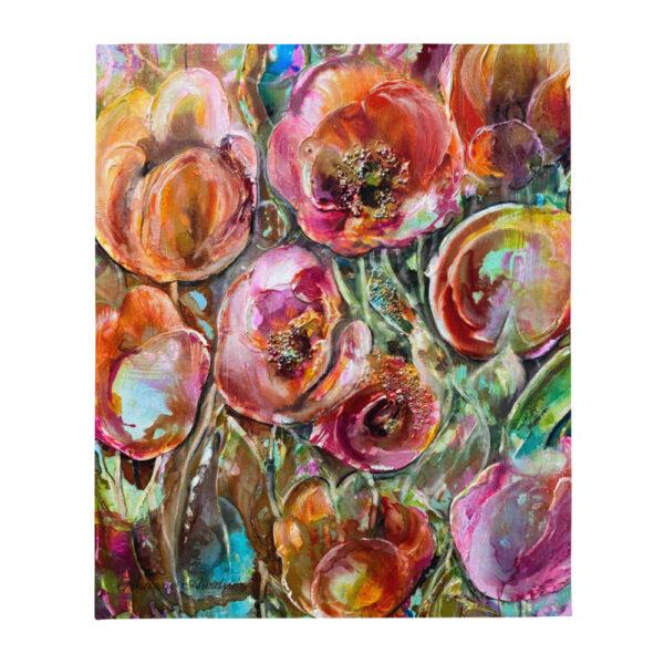 Silkeslen pläd med färgstarkt mönster